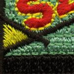 Powiększone zdjęcie haftu