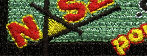 Powiększone zdjęcie naszywki z logo