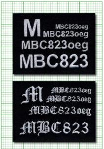 Małe litery na tle papieru milimetrowego. Znaki mniejsze niż 4mm są nieestetyczne i nieczytelne.